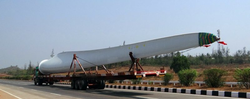 wind turbine blade being transported with a truck