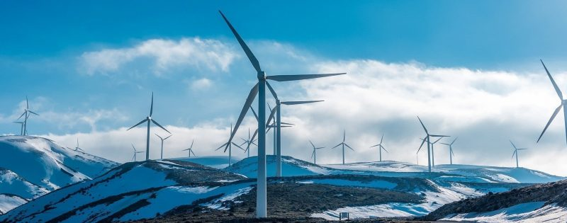 wind turbines located on a mountain